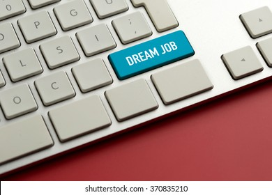 Computer key showing the word DREAM JOB
