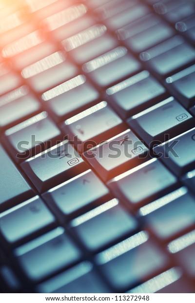 Computer keyboard background. Shallow DOF.