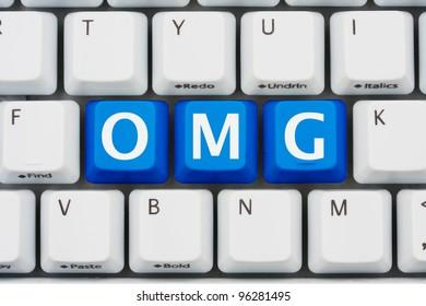 A computer keyboard with blue keys spelling OMG, Internet slang