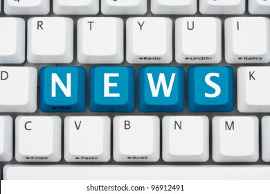 A computer keyboard with blue keys spelling news, Getting your news on the internet