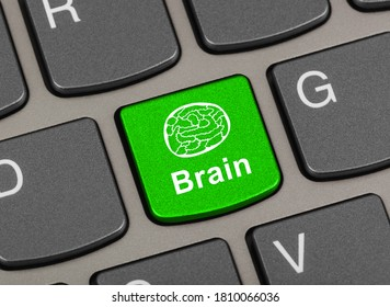 Computer keyboard with brain key - technology background