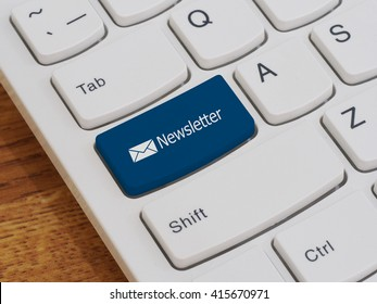 Computer keyboard button with newsletter text
