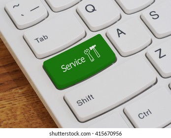 Computer keyboard button with service text