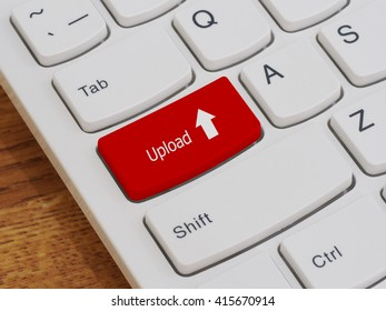 Computer keyboard button with upload text