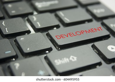 computer keyboard button with word development concept
