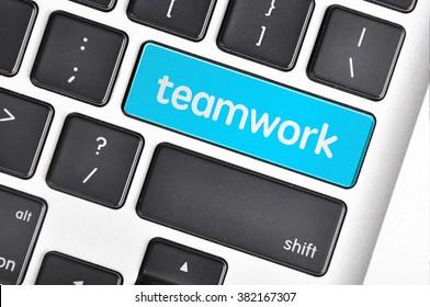 The computer keyboard button written word teamwork .