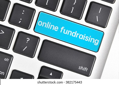 The computer keyboard button written word online fundraising .