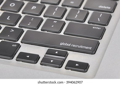 The computer keyboard button written word global recruitment .