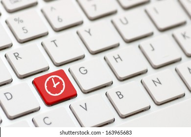 Computer keyboard with Clock icon on enter button background
