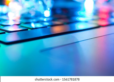 Computer keyboard close up with colorful backlight soft focus