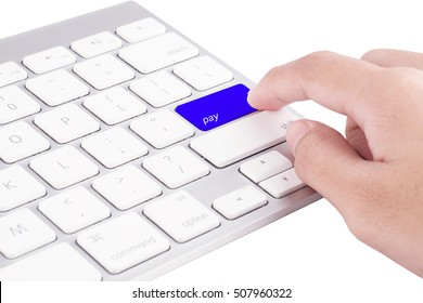 Computer Keyboard Concept: Hand pushing PAY keyboard button.