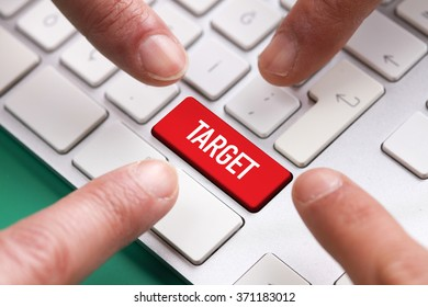 Computer Keyboard Concept: Many fingers pushing red TARGET keyboard button