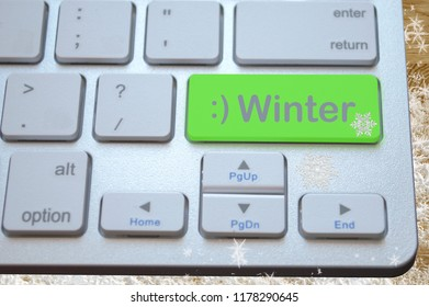 Computer keyboard with a green key Winter on a snow background