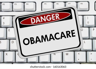 Computer keyboard keys with danger sign with word Obamacare, Obamacare