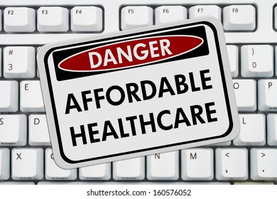 Computer keyboard keys with danger sign with words Affordable Healthcare, Affordable Healthcare