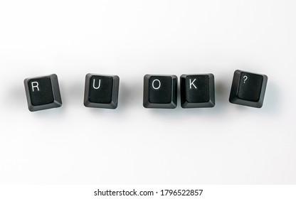 Computer keyboard keys spelling R U OK?, isolated on white background