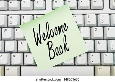 Computer keyboard keys with sticky note with words Welcome Back, Welcome back to our website