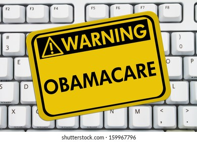 Computer keyboard keys with warning sign with words Affordable Healthcare, Obamacare
