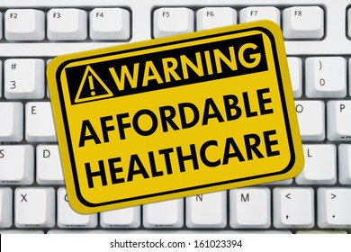 Computer keyboard keys with warning sign with words Affordable Healthcare, Warning of Affordable Healthcare