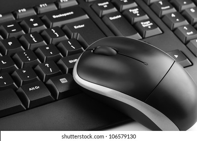 Computer keyboard and mouse isolated on white