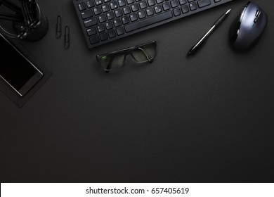 Computer Keyboard And Mouse With Office Supplies On Gray Desk