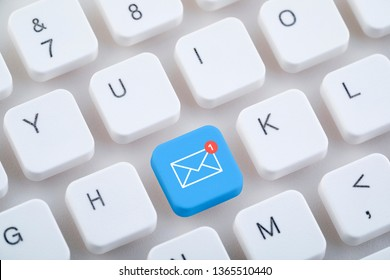 Computer keyboard with new email button.