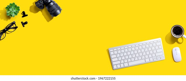 Computer keyboard and SLR camera from above