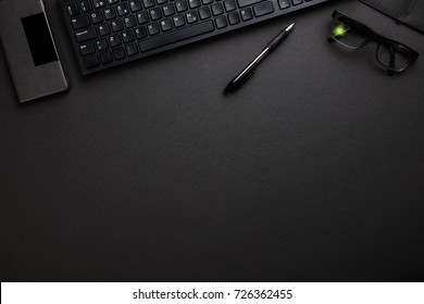 Computer Keyboard With Smartphone, Pen And Eyeglasses On Gray De