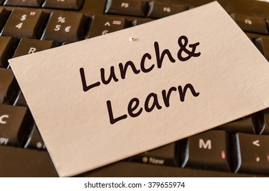 Computer Keyboard with white note and text lunch and learn