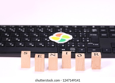 computer keyboard and wooden block and japanese senior sign