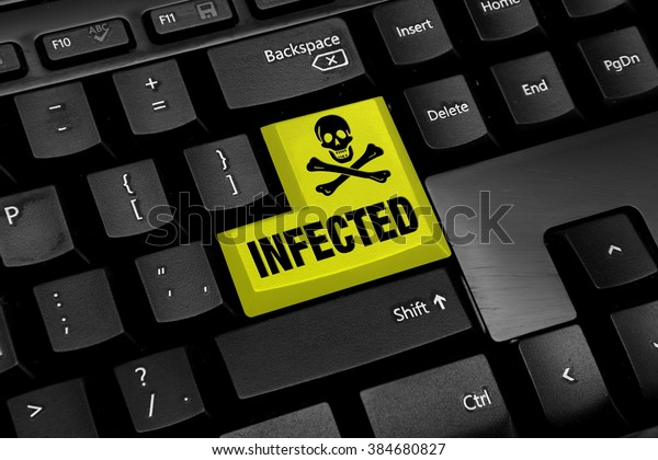 Computer keyboard with yellow infected virus button