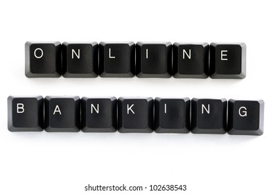 computer keys spelling the word banking on white background