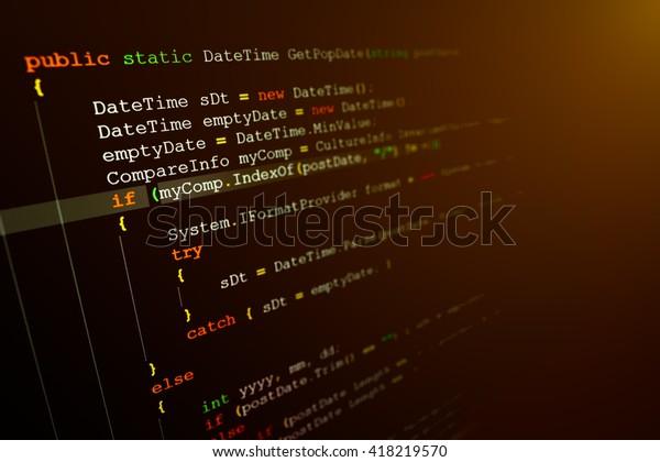 Computer language source code on computer monitor.