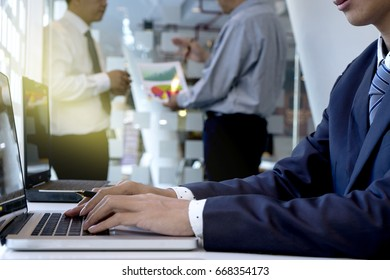 computer, laptop, man, business, using, businessman, office, hands, businessman working in his offcie hand on computer laptop and another team work talking in background