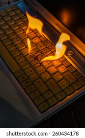 Computer laptop sleeve is on fire. Means love burns up the internet to set the world on fire damaged computers, insurance claims, etc. Hell.