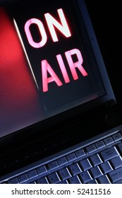 Computer live streaming Television symbolized by On-Air broadcast sign.  Vertical aspect.