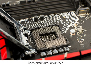 Computer Motherboard with empty and open CPU socket