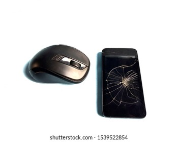 Computer mouse with broken smartphone. electronic repair concept