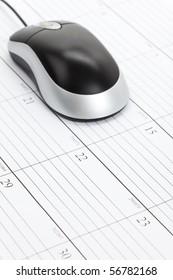Computer Mouse and Calendar close up