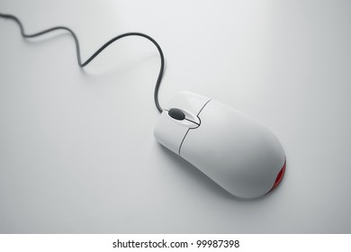 Computer mouse with cord on white background