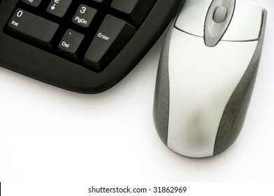 Computer mouse and keyboard in black and silver colors