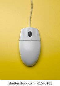 computer mouse on yellow background
