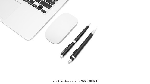 Computer with mouse, pan and pencil on the table