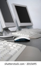 Computer Mouse and workstations in IT training classroom