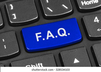 Computer notebook keyboard with FAQ key - technology background