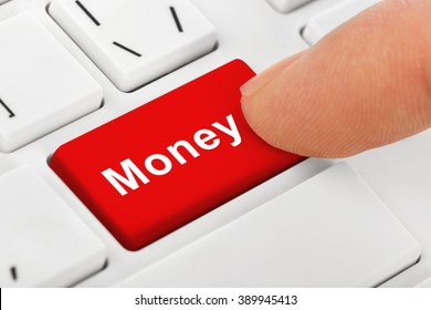 Computer notebook keyboard with Money key - technology background