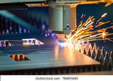 A computer numerical control (CNC) laser cutter quickly and effortlessly cuts through sheets of stainless steel.