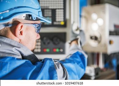 Computer Numerical Control Lathe Machine Operator. CNC Caucasian Technician.MEtworking Industry Equipment.