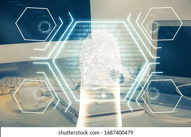 Computer on desktop in office with finger print drawing. Double exposure. Concept of business data security.