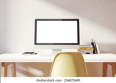 the computer is on the table in a bright interior